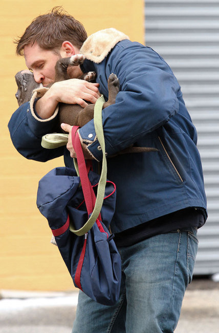 Tom Hardy Hugging His Puppy