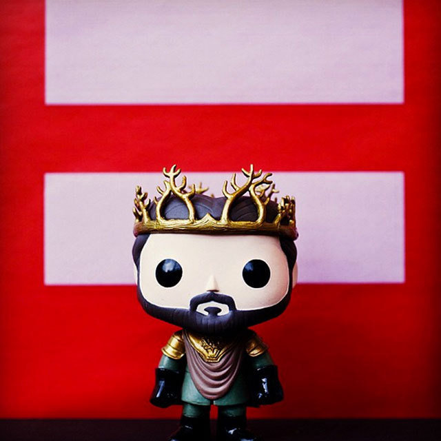 Renly doll from 'Game of Thrones' in front of equality symbol